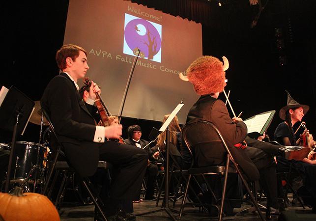 String+Ensemble+prepares+for+beginning+of+the+concert