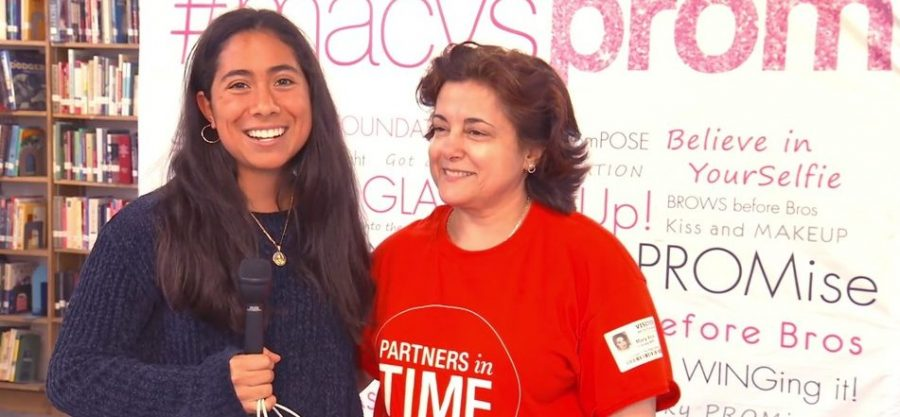 Senior, Claribel Alcantar, with a volunteer during the event.
